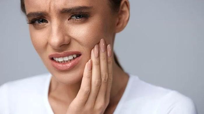 Trồng răng giả có đau không, có nguy hiểm gì không? 1